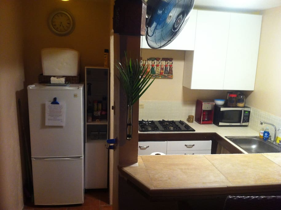 The refrigerator and storage for food, spices, etc. are separated from the cooking area.
