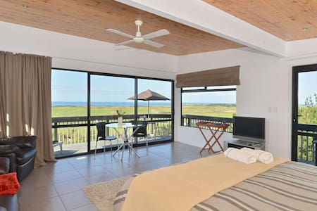 *Elevated Sea and Coastal Views Over World Class Beach *One Bedroom Self-Contained Unit with Wrap Around Deck *Easy Access to Surrounding Bays *Shared Use of the Spa