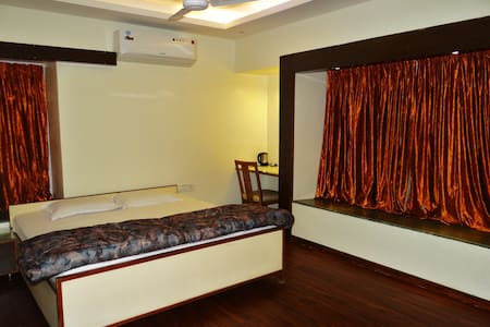 This little cozy apartment comprises of 3 private bedrooms, a common lobby and kitchen area. Each room is private along with attached bathroom, aircon, wifi, kettle and LED TV.