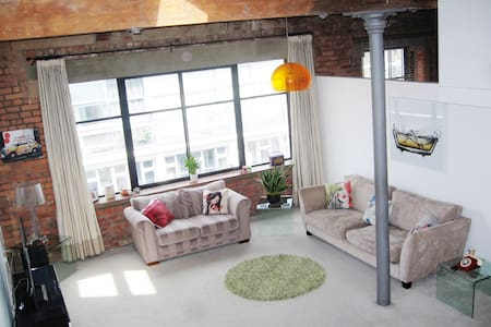 With vaulted ceilings over 15ft high, large wooden beams, exposed brickwork, fire place feature, design lighting and modern touches throughout, our Loft provides a relaxing and calm environment in the heart of Manchester's Northern Quarter.