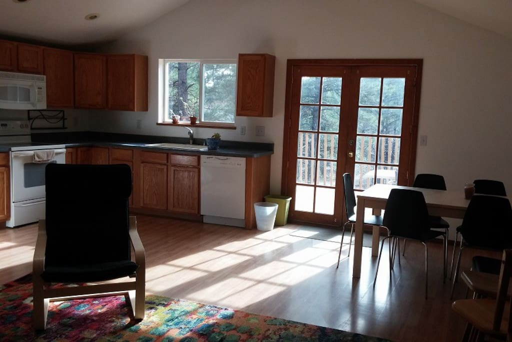 Full kitchen with microwave, oven, dishwasher, full fridge, dishes, pots, pans, utensils