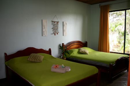 Casa Alice is a safe, nice lodge run by an italian family. It's located in a beautiful tropical garden 800 m from the beach and world class surf spot. This room usually have private bathroom. It depends on the availability. Shared during festivity.