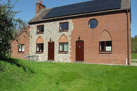 Charming ground floor flat, in a renovated rural stone and brick cottage.  Large double bedroom, kitchen diner, lounge, shower room and utility room.  Approx 64sq m floor space.  Fully furnished, centrally heated,  free wifi & electricity.  Parking.