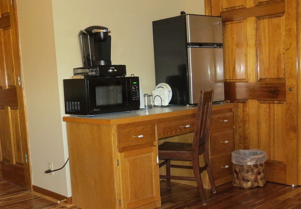 The kitchen area features a Keurig coffee maker, microwave, and a nice sized refrigerator.
