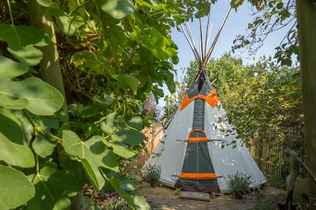 Our peaceful tipi is set in large wild garden provides the perfect getaway whilst still being just 10 minutes walk from the city centre.   The tipi sleeps two people and you can enjoy the lovely garden and use of kitchen and bathroom in the house.