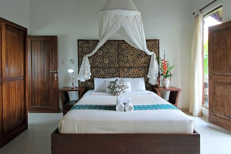 It is decorated by a wonderful touching of limited artwork - makes a fabulous Image of room, beautiful mosquito's net, huge bathroom area with flower vase, balcony with  table in unique setting, excellent fabric providing with soft & nature color.