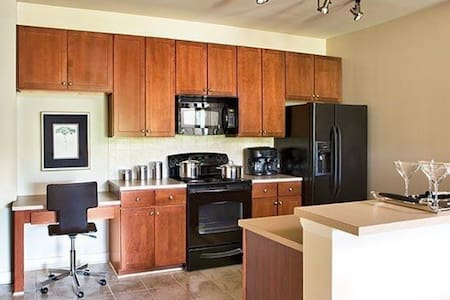 With modern decor, a spacious kitchen and living room, this apartment is located in the heart of downtown Greenville.  Walking distance to all excellent restaurants, shops, and parks. Towels & shampoo/conditioner provided.