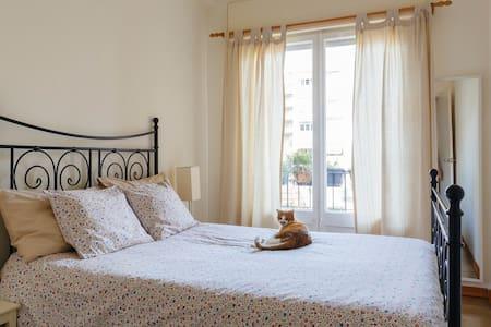 Cozy double bedroom with balcony