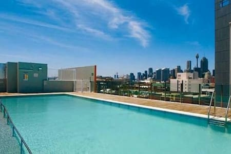 Free city rooftop pool and gym