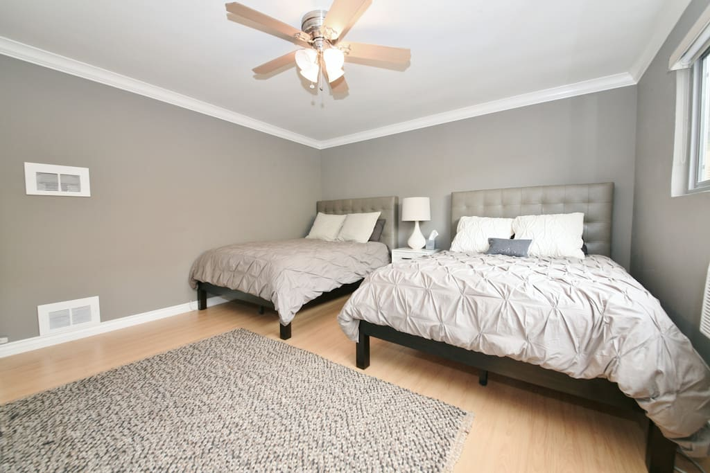 Bedroom with overhead fan, air conditioning, black out shades and huge closets with hangers.