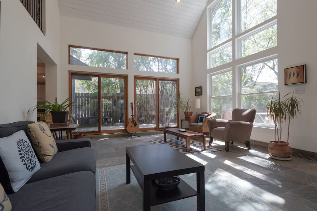 Floor-to-ceiling windows offer a welcoming setting all day long.