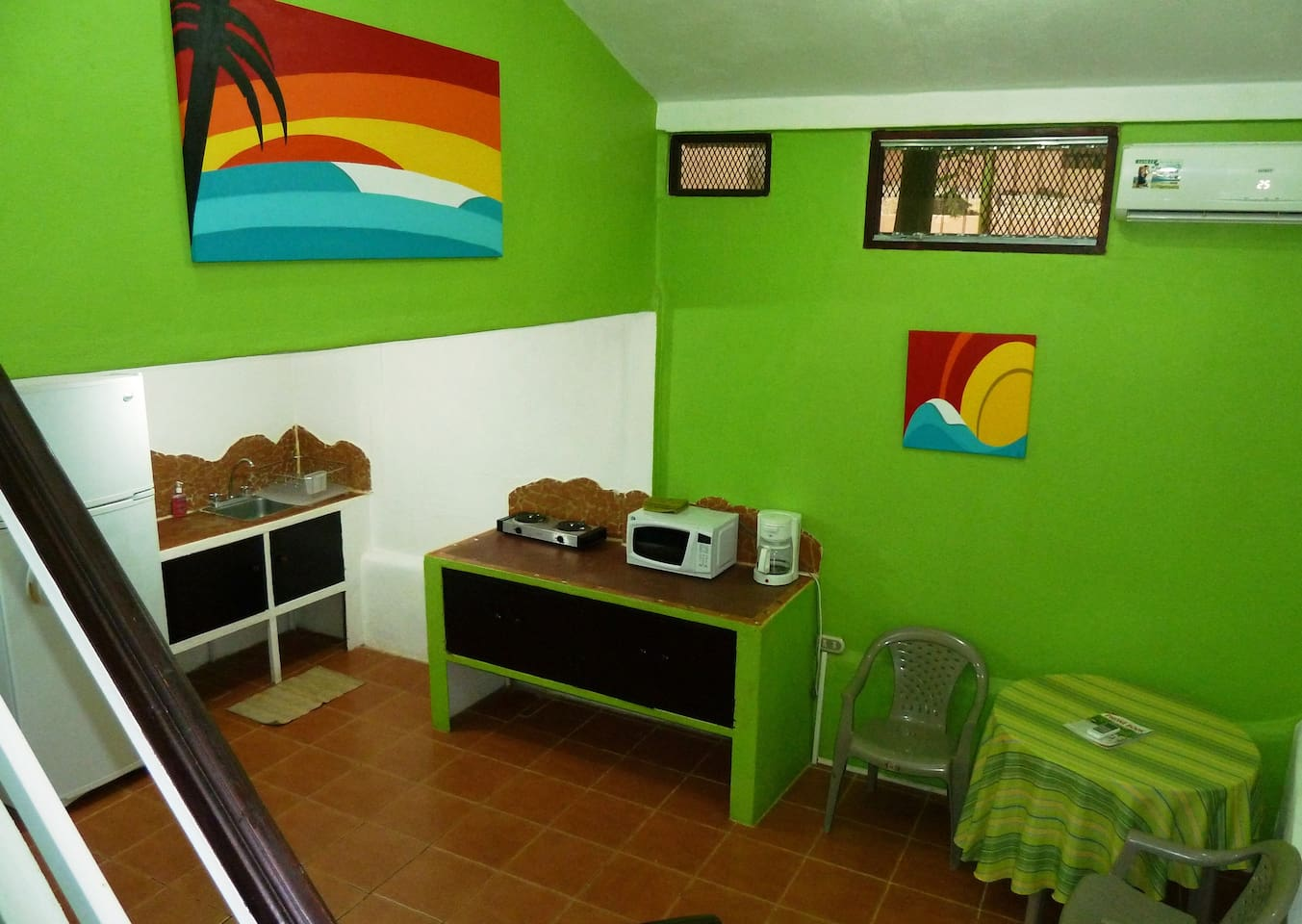 Kitchen and dining area with some of the locally made paintings