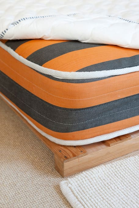 Real bed with wood base, good mattress and mattress cover
