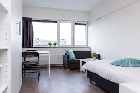 Cozy studio 15 min from the center,2 min from bus station,close to metro/tram station,1min from supermarket.It is located in a friendly and quiet neighborhood of Amsterdam.Private kitchen and bathroom.Bike parking space available.