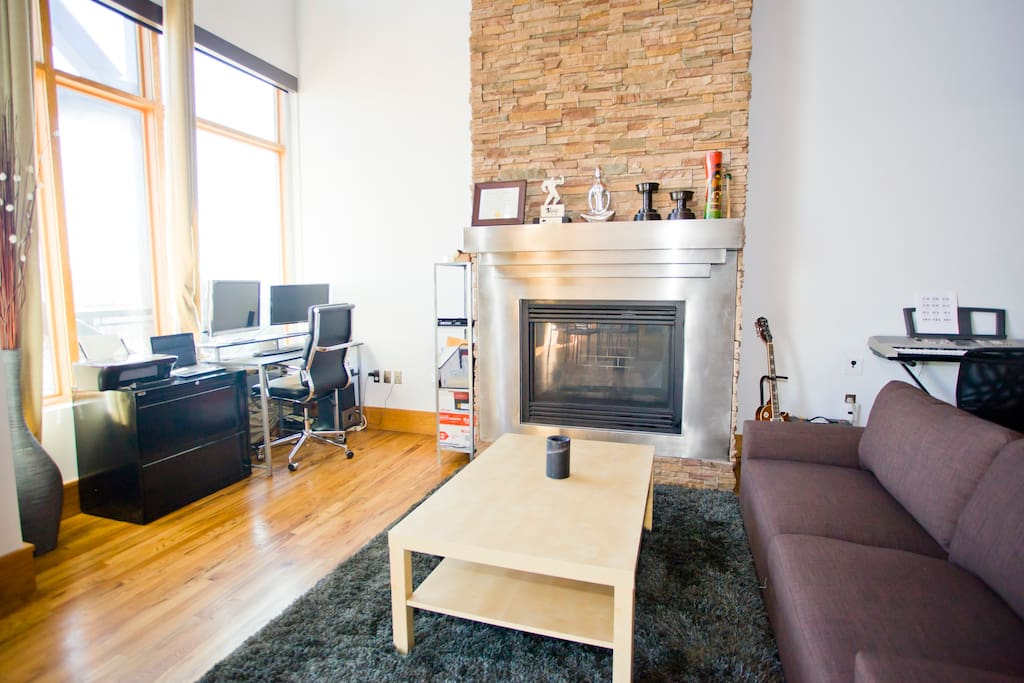 Cozy up to the 30ft fireplace. We've upgraded the furniture in this room since this picture was taken