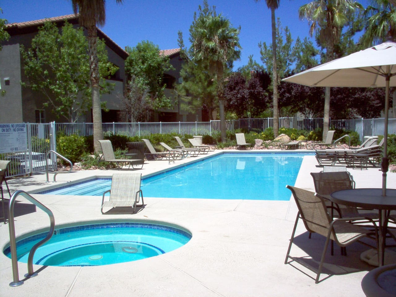 one of 3 pools and spa, clubhouse  gym  raquet ball walking path grassy area