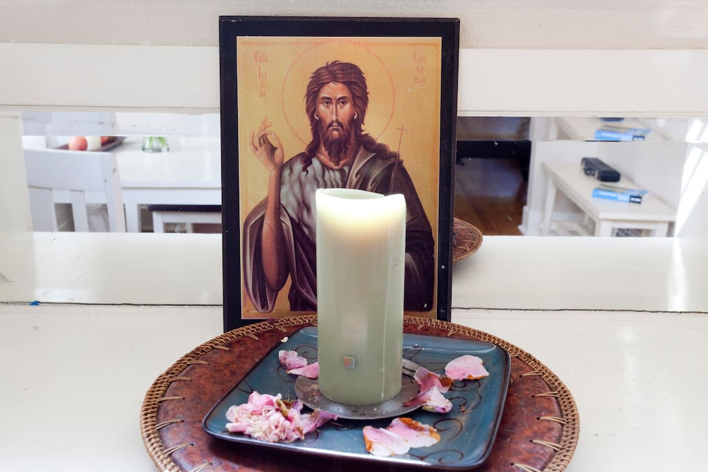 Candle with Orthodoc icon.