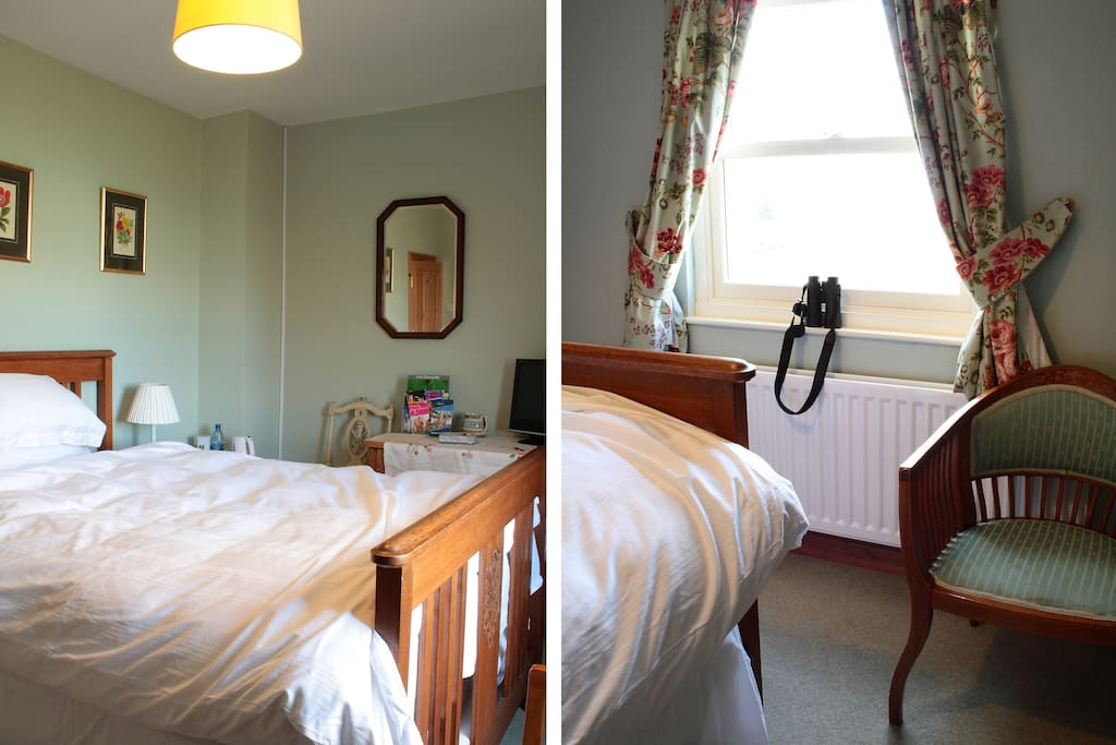 This is the Green room, showing the standard double bed.