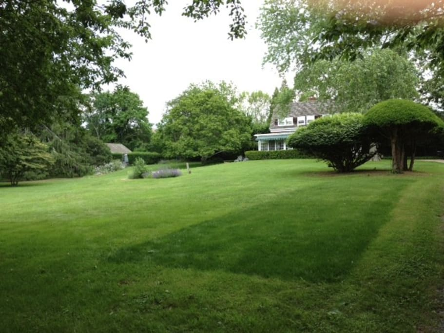 Cottage to left of main house. View coming from road and down driveway.