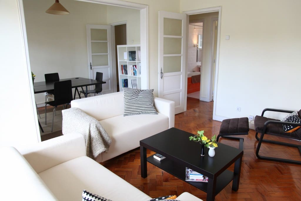 living and dining room. Wooden floors, comfortable chairs.