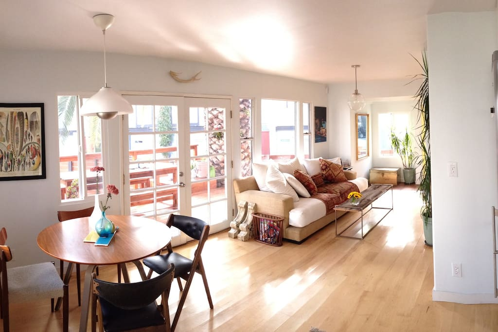 Main living space - open to outdoor living space including a large outdoor farm table for entertaining.