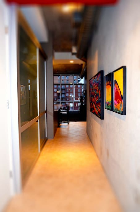 Fabulous original artwork adorns the entrance along with state-of-the-art sliding door system