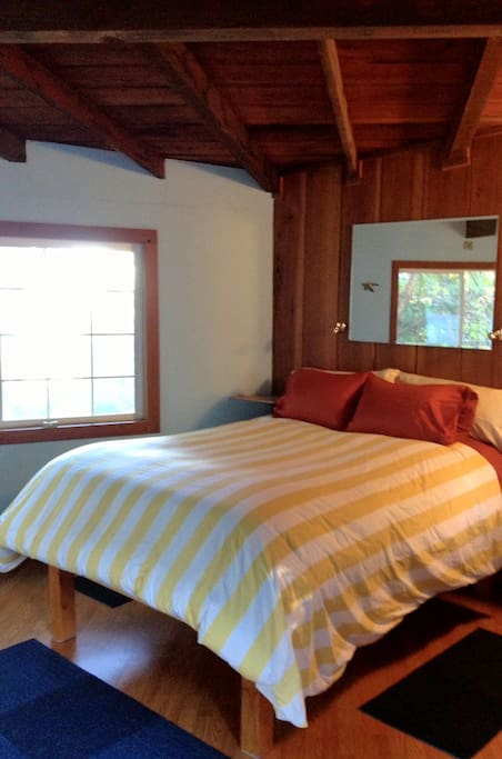 Your comfy queen, with feather bed and views!