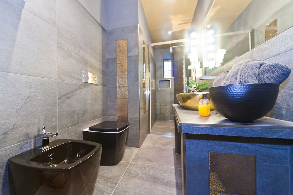 Italian design all through the  bathroom.Our bathroom is made in Italian slated rock and real 24K gold/platinum tiles that are hand painted by artisans up north.