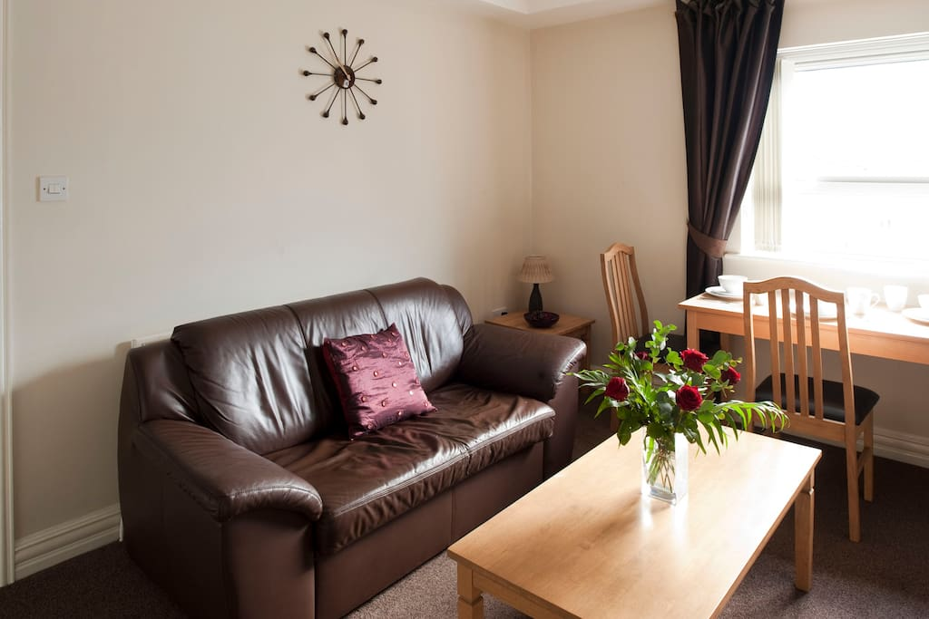 The apartment features a leather sofa bed, plus an oak coffee table.