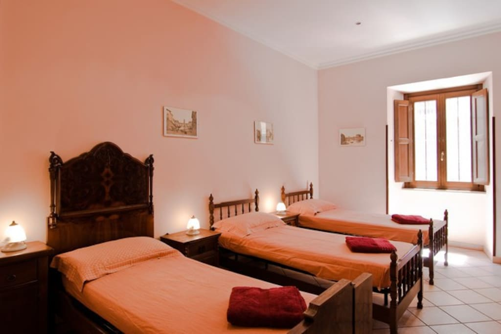Your private room with three single beds