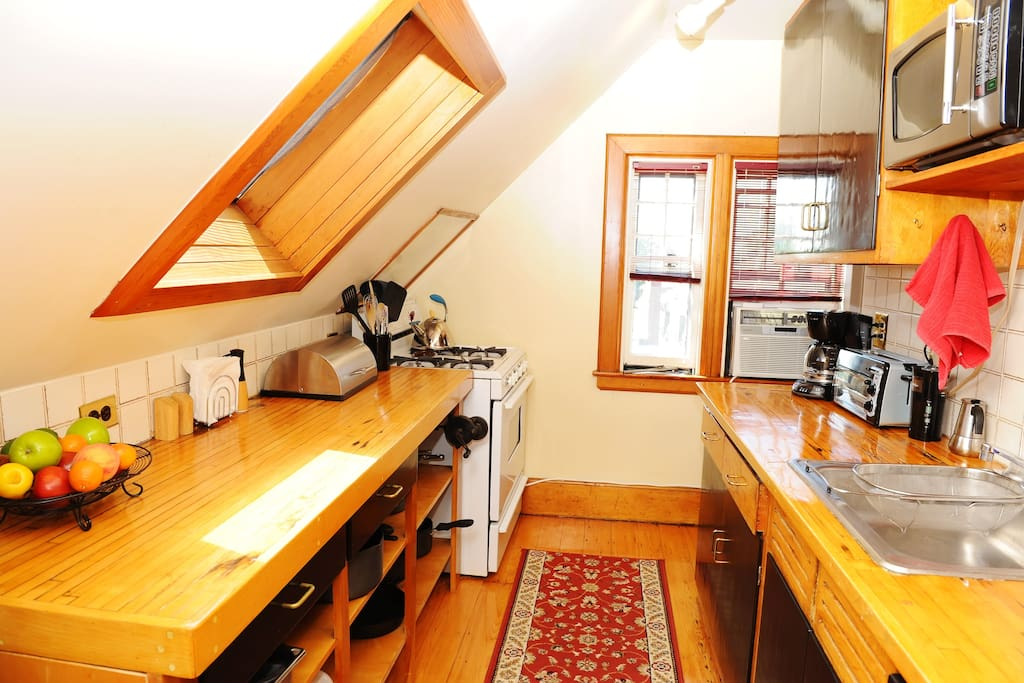 Galley kitchen comprised from reclaimed bowling alley !