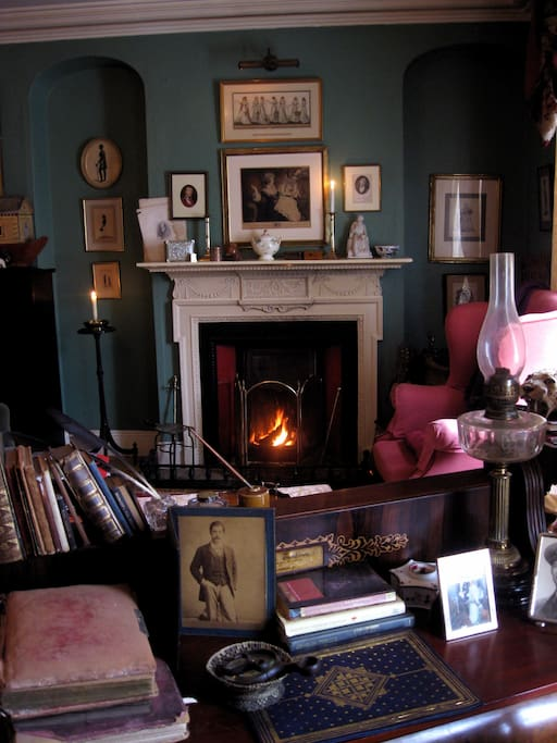 The drawing room fireplace. Sit here with a welcoming glass of wine in the evening, or book afternoon tea ahead of your arrival. For fireside suppers of delicious Guinness Casserole or Lamb Stew with cider, also book ahead.