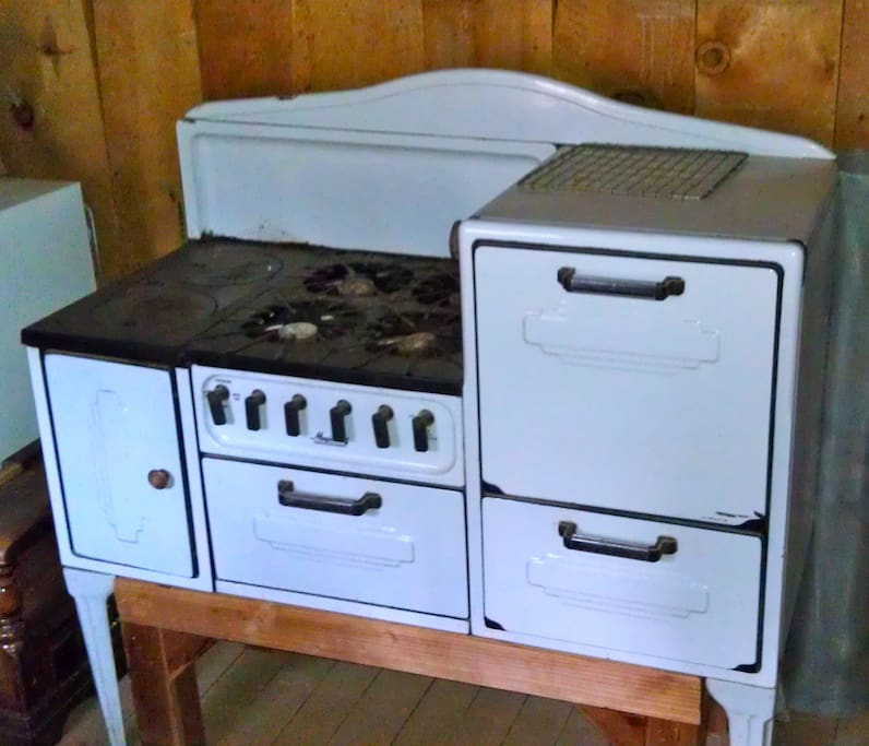 Dating from the '30s, this vintage cast-iron stove -- complete with griddles, burners, oven, and broiler -- still works like a charm.