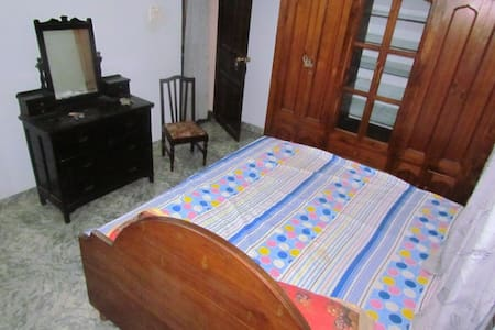 This is the blue room.  It has a king size bed for two. It has bathroom with shower (hot & cold). Located at a very short walking distance from the beautiful Velsao Beach where u enjoy the nature sun & sand all for yourself.