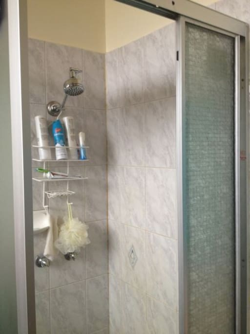 Shared bathroom with laundry facilities