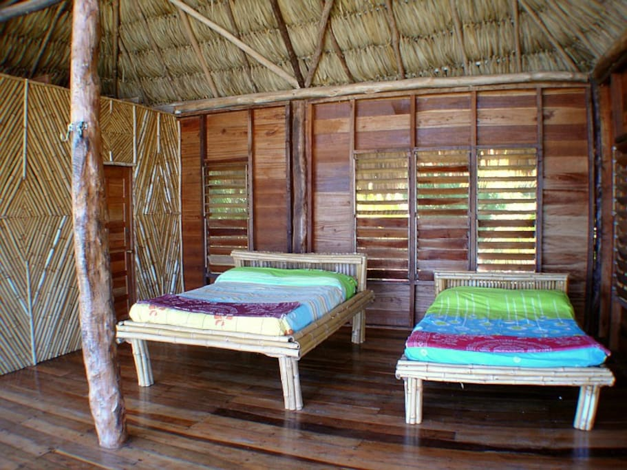 Bamboo used from our own property. Private bath, hammocks, wood louvered screen windows, and 2 full size beds.
