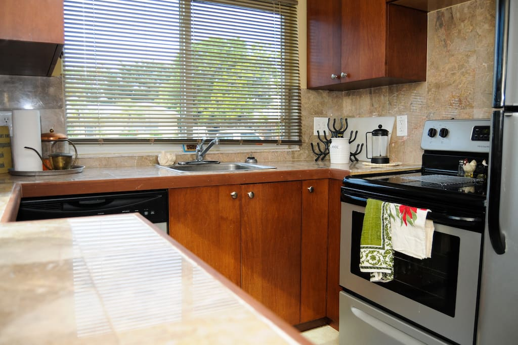 Kitchen has all appliances, coffee maker, pots, pans, dishes and glassware.