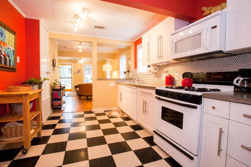 Bar area and spacious fully stocked kitchen with gas stove, pots, pans, spices and dishes for your cooking convenience.