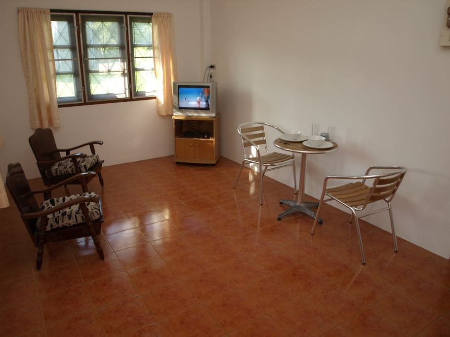The main living area of the house includes 4 chairs, small table, Television with Cable TV plus DVD/CD/Blue-Ray player.