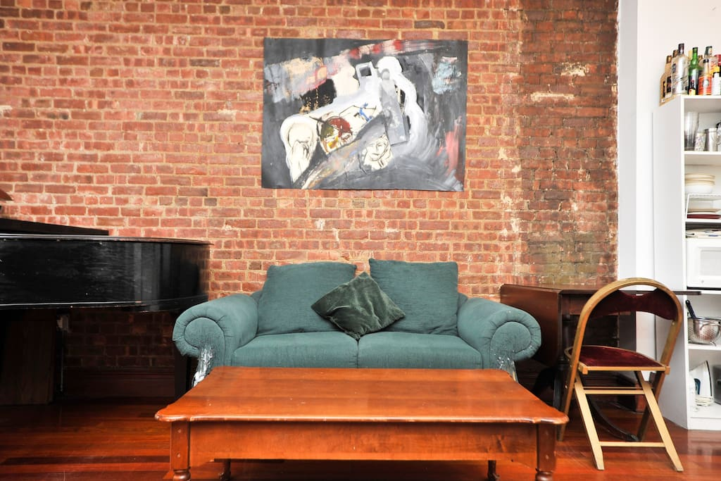 Living room - the couch, brick wall and original artowrk