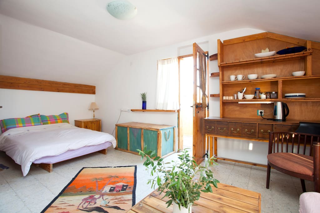 The upstairs bedroom which is large, bright and leads on to the balcony with fantastic views of the Red mountains