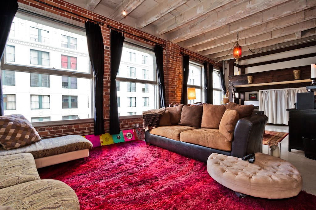Living room with red shag carpet.