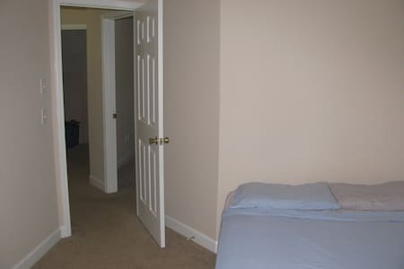 Empty bedroom with bed and AC