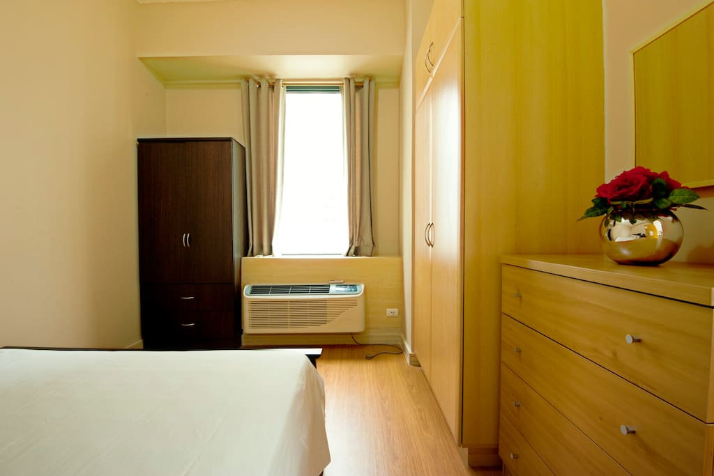 Bedroom aircon unit and additional cabinet for long-staying guests
