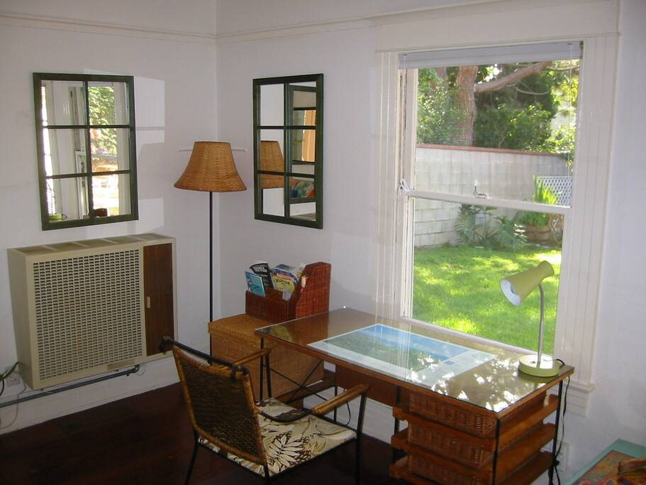 Living Room/West view + Retro Wicker Desk + View onto Back Yard + Satellite/Flat TV + DVR