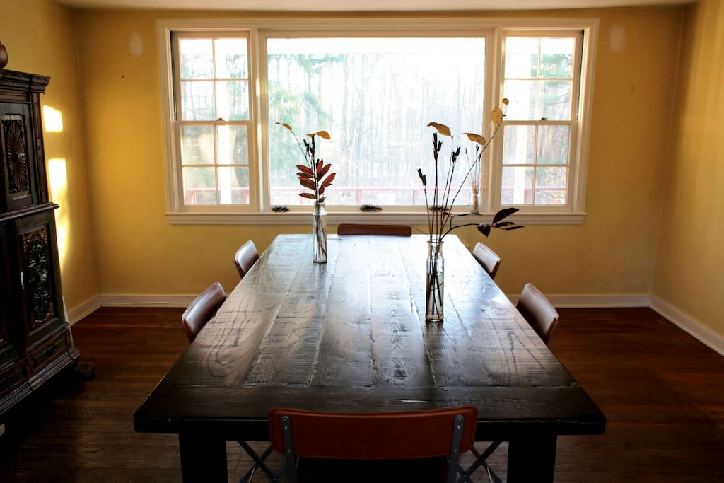 The dining room has a beautiful view of our woods.