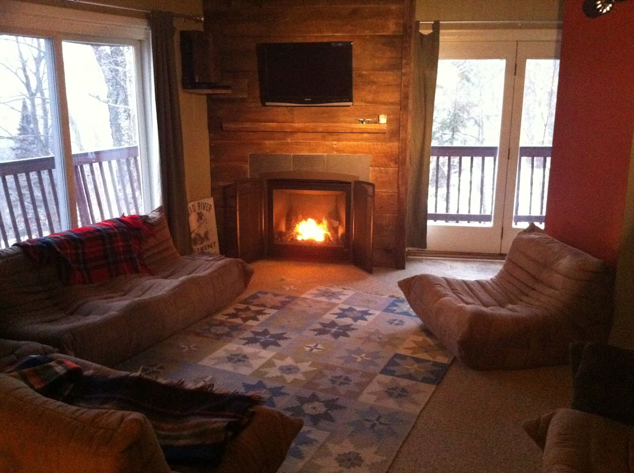 Living room offers lounge seating with premium cable, sound system, and an amazing fireplace.