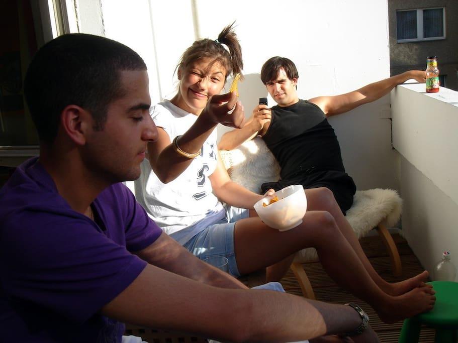 Saher, Seda and Cem are enjoying sunset on the balcony