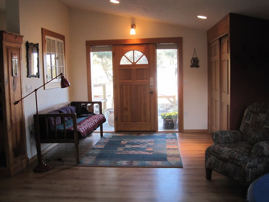 Entry foyer with large closets and an extra daybed