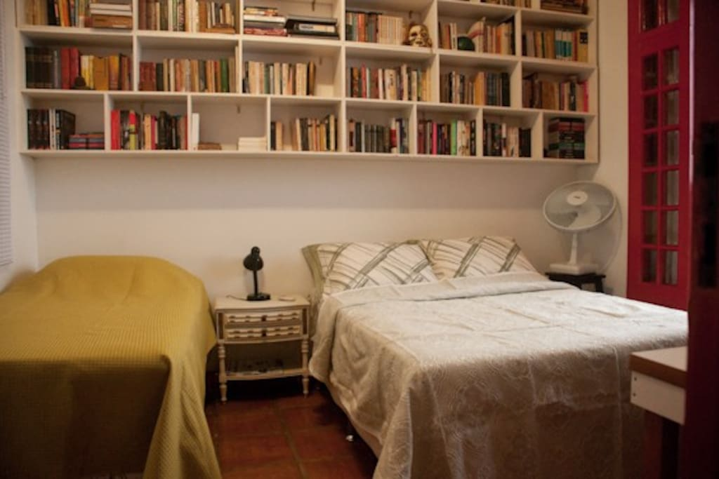 The Guest room with a double bed and a single bed